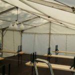 Festzelt 6x12m Innenansicht mit Bierzeltgarnituren in Hannover